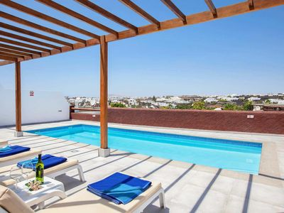 Photo for Easy reach of bars, restaurants, shops, beach ; Three Bedrooms, air conditioning, terrace and pool.