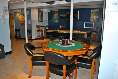 Poker table with cards and chips.