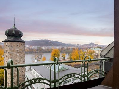 Photo for Two-level, riverside penthouse w/ amazing views of Prague Castle & the city!