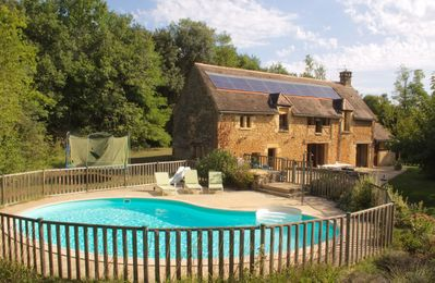 Photo for Charming old stone house near Sarlat, secluded on a hilly position, nice private swimming pool...