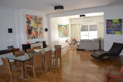 Large living and dining areas with immaculate hardwood floors and a balcony too.
