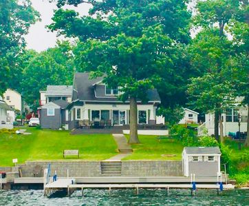 View of the house and waterfront from the lake.
