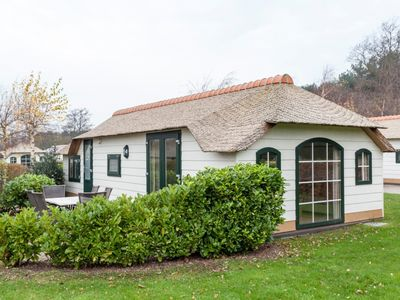 Photo for Bungalow in the holiday park Landal Schuttersbos - Bordering dune and woodland area
