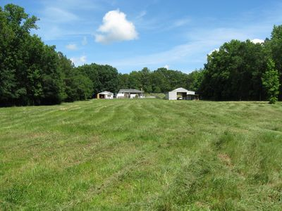 Back pasture, horse barn with stables for 4 horses and the house