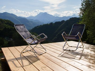 Photo for Romantic chalet in the nature with pool and panoramic view on the mountains
