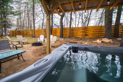 Great outdoor space, hot tub, sitting area, fire pit