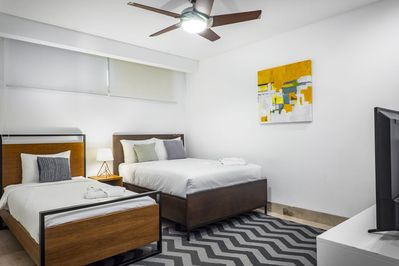 Guest bedroom with QS bed and single bed and Smart Tv