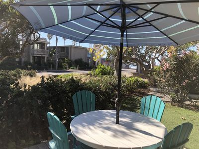 Enjoy relaxing on your ocean view private patio with adjoining grassy area!