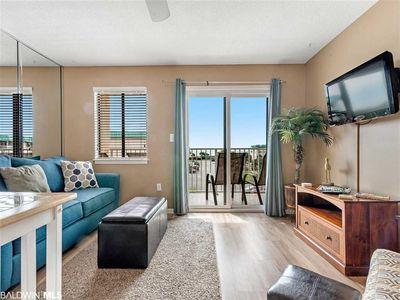 Photo for Family friendly beach front condo with great views of sugar white beaches.