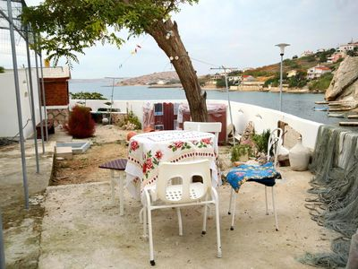 Photo for Two bedroom apartment with terrace and sea view Zubovići, Pag (A-4082-b)