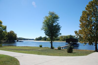 Level back yard with easy access to private boat dock, water, private boat ramp