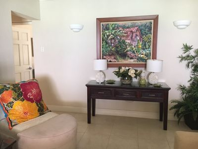 The condo features many beautiful local original works of art
