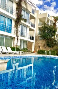 Pool & apartment front