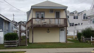 Photo for CLASSIC shore home feel and is only steps to the beach and boardwalk with some ocean views from the deck