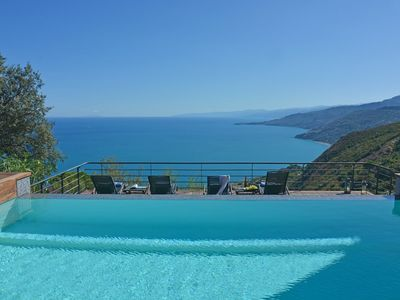 Photo for Charming villa with infinity pool and extensive terraces with spectacular sea and mountain views
