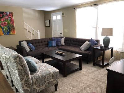 Sunny comfortable living room with cable tv and wifi