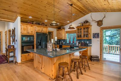 Kitchen adjoining Great Room, & Rear Deck. This Floor also has a 1/2 bath