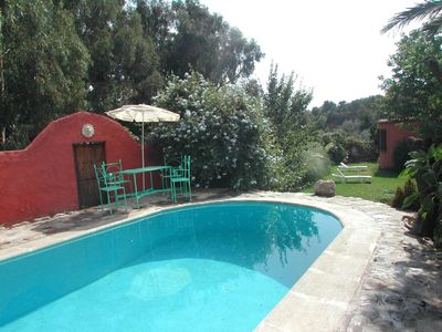 Photo for Secluded idyll! Cottage, 10 min walk to town: own pool, air-con, WiFi, pingpong