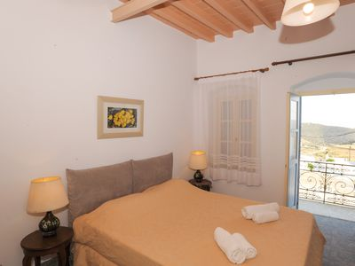 Photo for Amorgos traditional apartment with balcony view