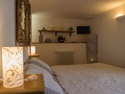 Photo for Romantic retreat for two in the heart of a green garden a few steps from the sea