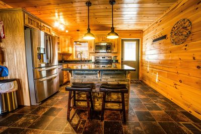 The beautiful hickory kitchen has plenty of space for your culinary needs!