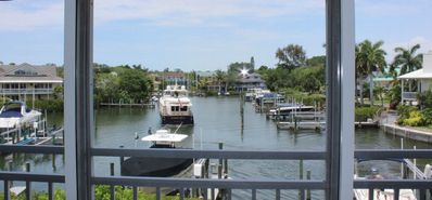 Photo for On Siesta Key - Watch the boats come into the harbor from your lanai!