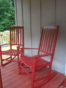 Rocking chairs on the covered porch in front of cabin.