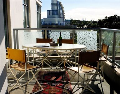 Balcony with large table and al fresco dining with 6 chairs