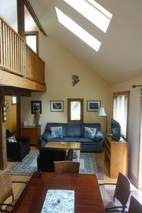 Living area, upper loft to the left. Couch has pullout queen bed.
