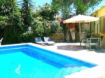 Photo for Relax by your private pool surrounded by trees, flowers or wander down to beach