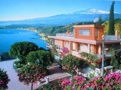 Photo for 6 Apartments in a Residence with garden and open view to the sea and Mount Etna