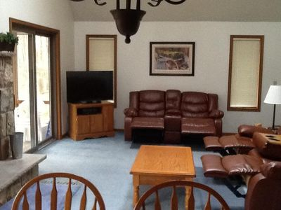 Living room with new furniture that features 4 recliners