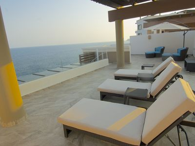 Photo for Penthouse Condo ft Panoramic Views & Private Rooftop Terrace - Punta Arrocito