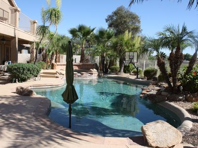 Photo for Oasis in the desert! Pool, hot tub, putting chipping green, outdoor bar.