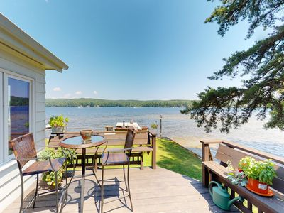 Photo for NEW LISTING! Lakefront home w/docks, deck, firepits, paddle boat, dogs OK