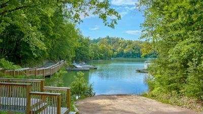 Photo for AUGUST SPECIAL!! LAKE CABIN/SLEEPS 14! HOT TUB/POOL TABLE/RESORT POOL!!!