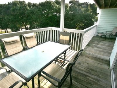 Photo for Family friendly condo with amazing amenities, pool and beach access, outdoor gazebos and recreation center with gym indoor pool/jacuzzi and lounge areas.