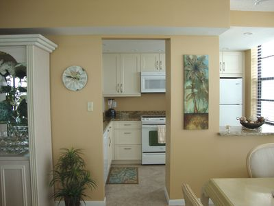 Kitchen is brand NEW- bright, clean & well equipped-- open concept to dining rm.