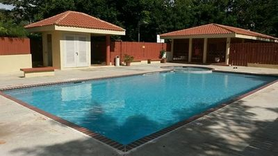 Photo for Lovely condo w/ pool in gated community near beaches, shopping, and attractions