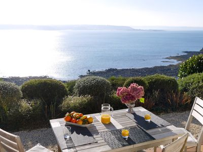 Photo for Spectacular sea view, 4 **** south full rental quiet, feet in the water