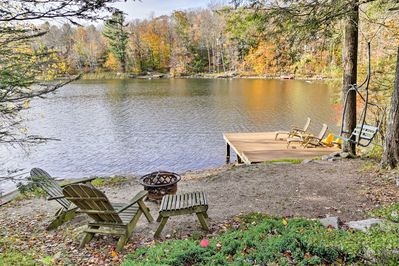 Spend days swimming, fishing, kayaking, and stand-up-paddleboarding during your stay at this  3-bedroom, 2-bathroom vacation rental home in Tolland!
