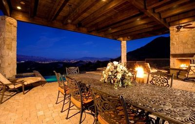 Patio with wood burning fireplace and gas fire pit