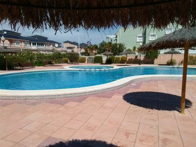 Photo for Sunny apartment with pool, private sundeck & parking