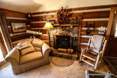 Living room with sleeper sofa, TV and stone fireplace