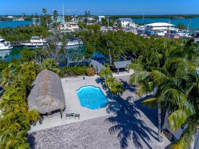 Photo for Incredible Updated Waterfront 5 BR House with Giant Tiki, pool and huge dock