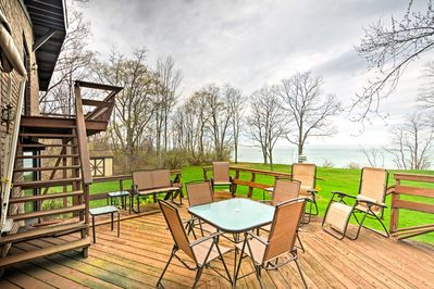 Nestled on 2.3 acres of shoreline, the house has a 2-tiered deck and fire pit.