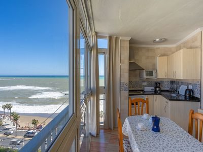 Photo for Light-filled Studio Apartment On the Beach with Pool & Unforgettable Sea View