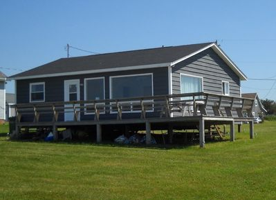 Front of cottage. Large living room windows and back door face the ocean.