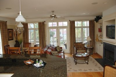 Dining, great room leading to screened porch