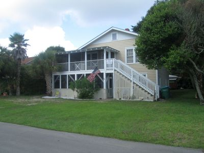 Photo for Family Favorite, walking distance to beach, mid Island location